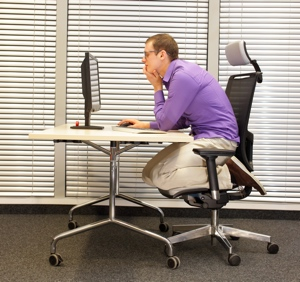 Office worker with bad posture