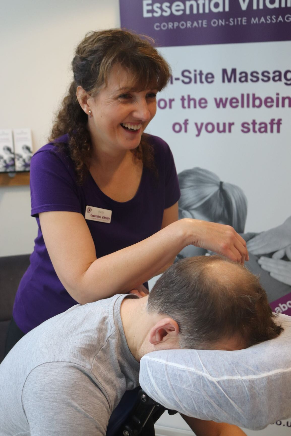 On-site massage showing seated Acupressure technique